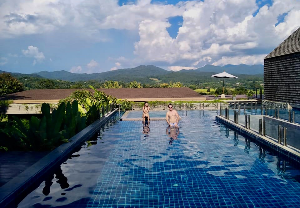 Sitting in the pool with Flo in Pai, Thailand